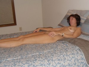 The Wife lounging naked on the bed
