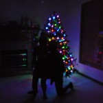 Low light photo of both of us in front of the Christmas tree