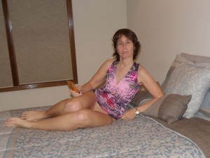 The Wife bottomless on the bed waiting for The Husband with flavored lubricant
