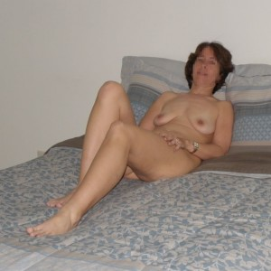 The Wife sitting naked on the bed