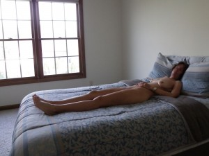 The Wife on the bed waiting for The Husband