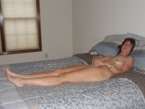The Wife hanging out naked in the bedroom waiting for The husband
