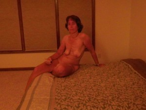 The Wife on the bed waiting for The Husband with a tube of flavored lubricant