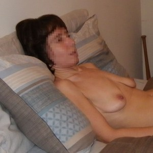 The Wife lying naked on the bed