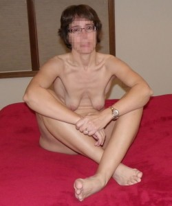 The Wife naked on the bed with her new eyeglasses