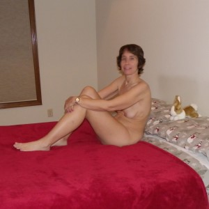 The Wife hanging out naked on the bed waiting for The Husband