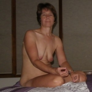 The Wife sitting naked on the bed with flavored lubricant