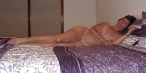 The Wife longing naked on the bed showing her early summer tan lines