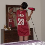 The Wife drying her hair wearing a #23 basketball jersey