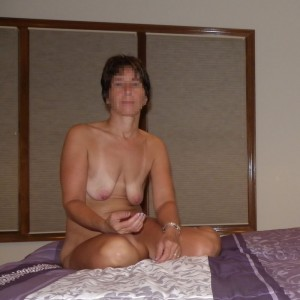 The Wife sitting naked on the bed with the last of the flavored lubricant