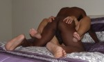The Husband on top of The Wife with her legs spread wide