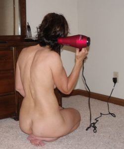 The Wife sitting naked on the floor drying her hair