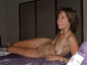 "The Wife naked on the bed after a ""photo"" session"