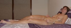 """The Wife sitting naked on the bed before a """"photo"""" session"""