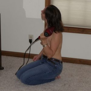 The Wife sitting topless on the floor drying her hair