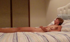 "The Wife sitting naked on the bed before a ""photo"" session"