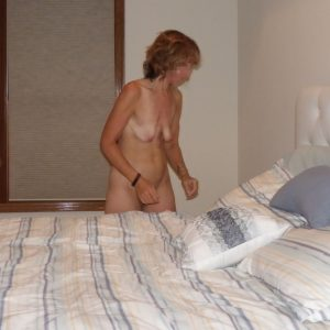 The Wife remaking the bed after a photo session