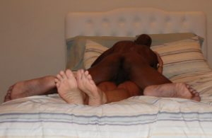 The Husband on top of The Wife with her legs together