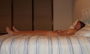 "The Wife sitting naked on the bed after a ""photo"" session"